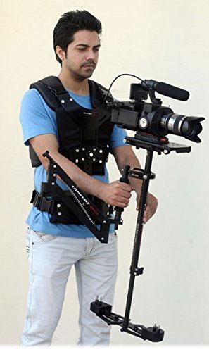 Man holding a camera using the flycam hd-5000 stabilizer